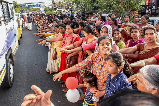 "Kochi: Thousands of women take pledge while participating in the 'women's wall' against communalism and gender discrimination, in Kochi, Kerala, Tuesday, Jan 1, 2019. Lakhs of women in Kerala participated in the 620 km-long ""women's wall"" – from Kasargod in the north to Thiruvananthapuram in the south – to send a message of gender equality. (PTI Photo) (PTI1_1_2019_000128B)"